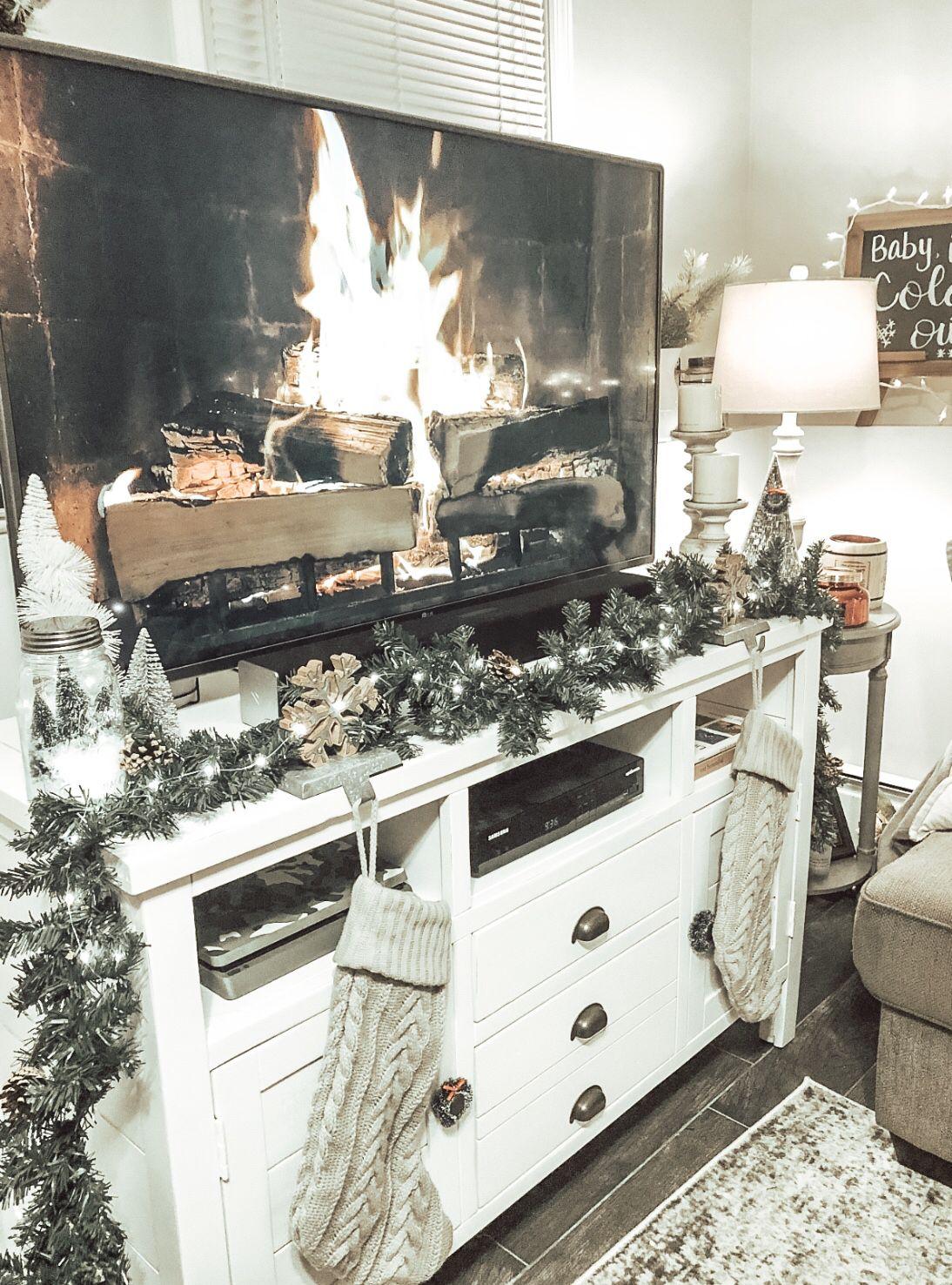 Tv stand Christmas decor, stockings, garland, twinkle lights