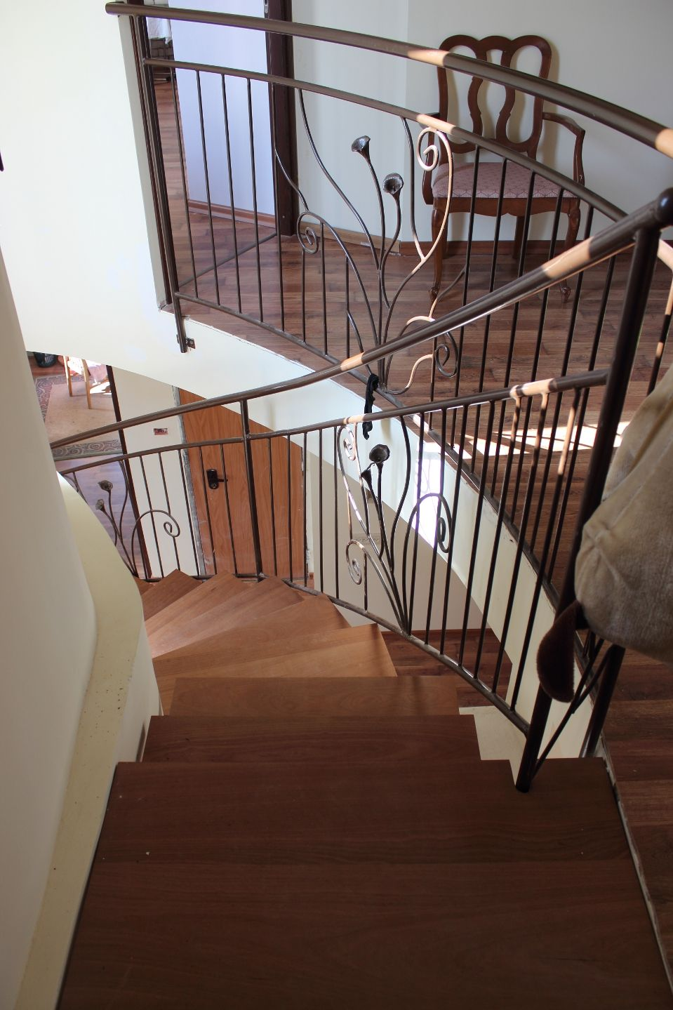 Wroughtiron staircase with mahogany stairs. Wrought