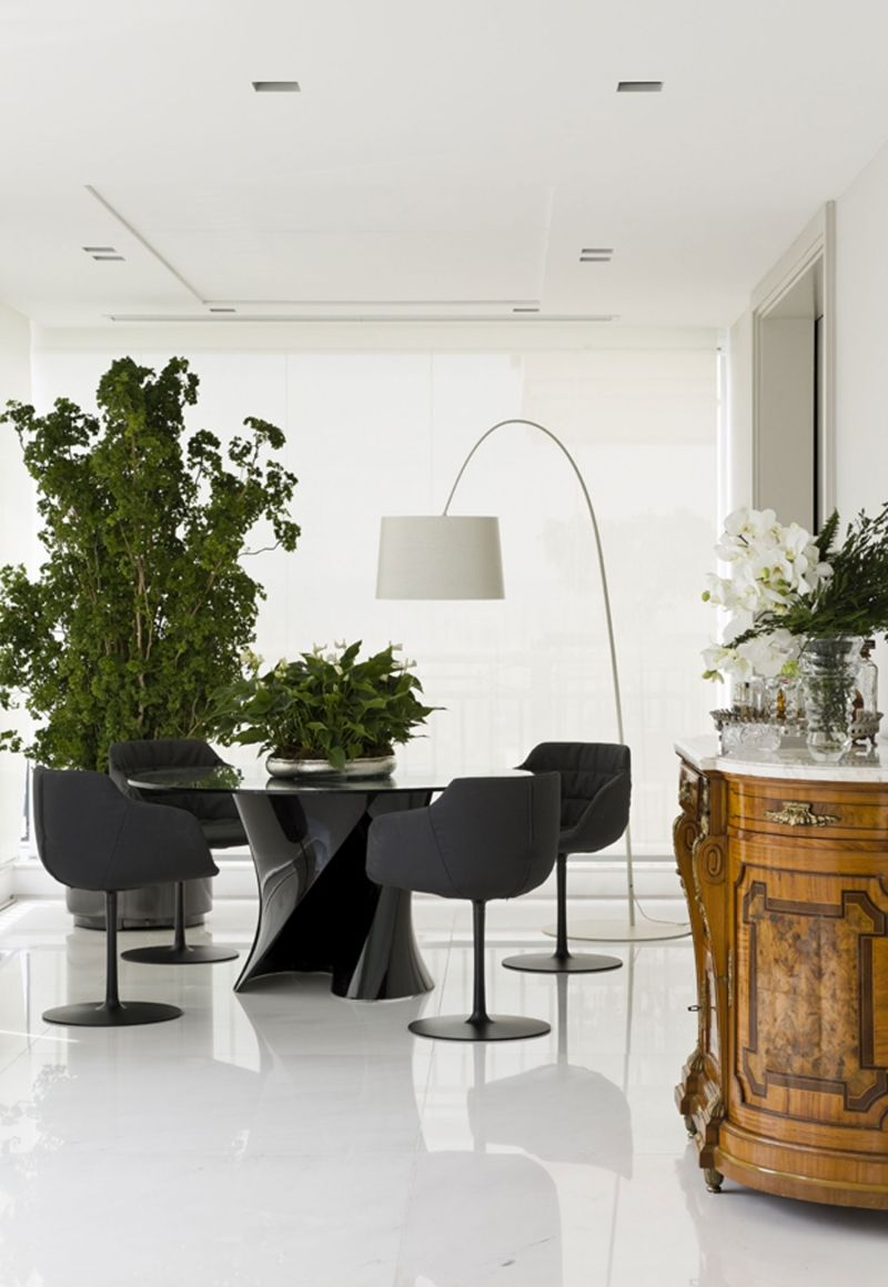 It's all in the Mix.....Modern Dining floating on high gloss white floors and an Antique sideboard......why not?