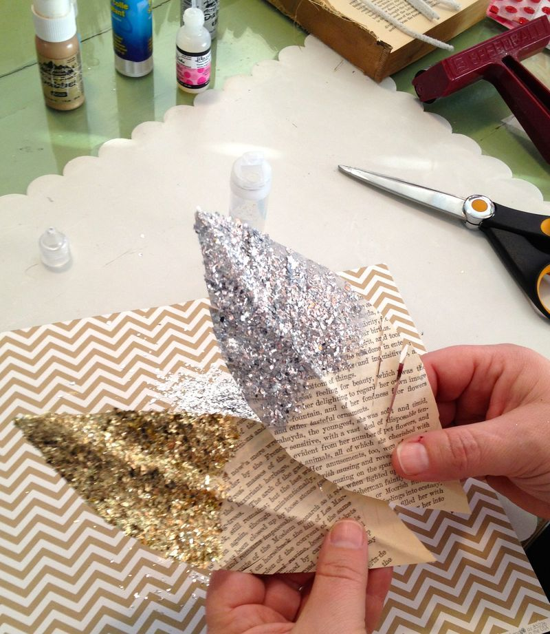 DIY Book page, pipe cleaner and glitter feathers via margieromney-aslett.typepad.com