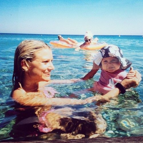 Baby Lux and Mummy Lou and (I think) Perrie photobombing the background