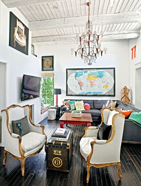 Colors pop in this living room, which is outfitted with clean lines and crisp blacks and whites - Traditional Home® / Photo: Colleen Duffley / Design: Berkley Vallone