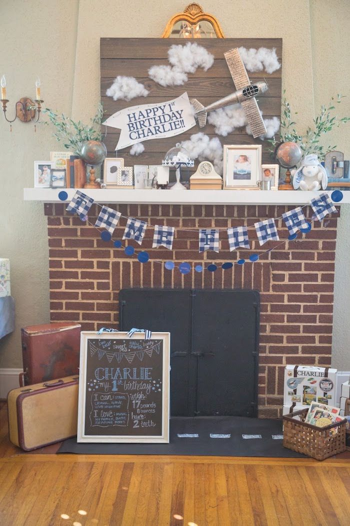 Fireplace decor from a Time Flies Vintage Airplane 1st Birthday