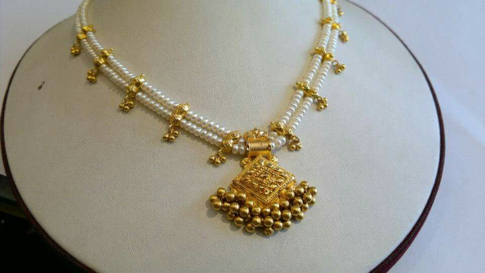 4bbf978c680cf Two Layered Pearl Necklace which has gold design with gold beads ...