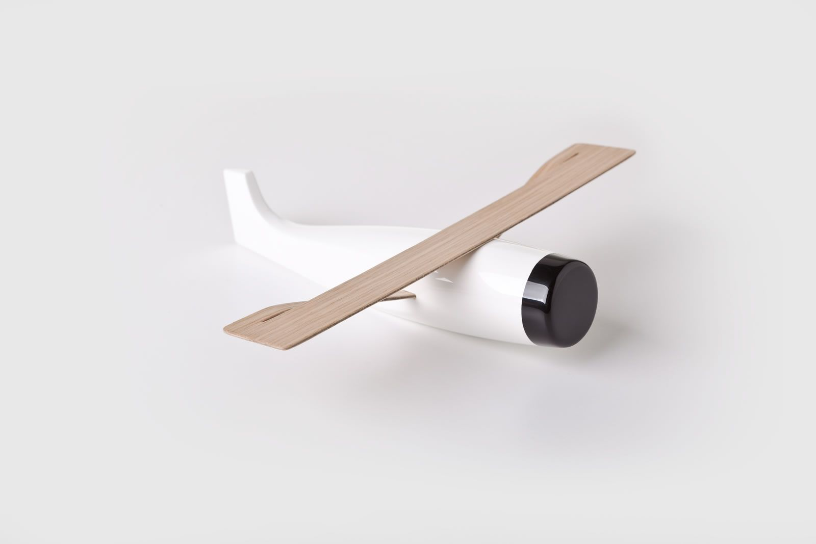 Woo Aeroplane by Roman Vrtiška & Vladimír Žák The solid wooden sculptures represent an airplane, a bulldozer, and a sailboat, each symbolizing air, earth, and water, respectively. The pieces are feature both naturally finished and colorful veneered accents, available in red or black. WOO Toys made their first big public appearance at Prague earlier this October at Designblock 2014.