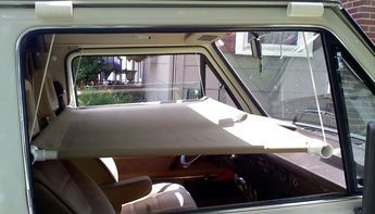 Ingenious Hanging Cot Idea to Add Sleep Space to Your Car, Truck or RV - http://www.doityourselfrv.com/hanging-cot-idea-sleep-space-rv/