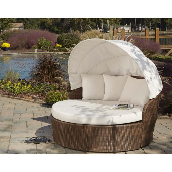 Take a nap in the great outdoors with this Panama Jack canopy daybed - Daybed Images