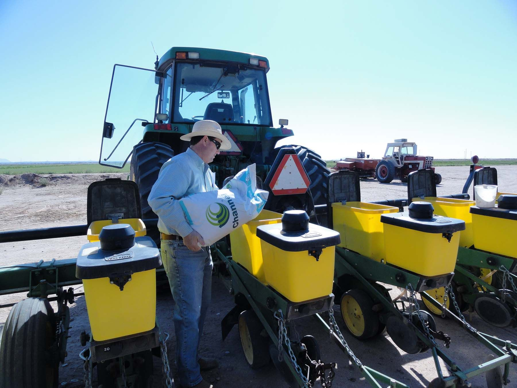 Bryan Hartman of Hartman Farms fills up his planter with seed. Our Arizona farmers and ranchers are busy growing things year around.