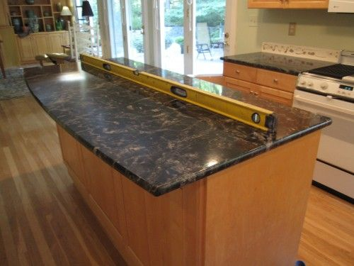 Natural maple cabinet with dark granite for the home for Maple slab countertop