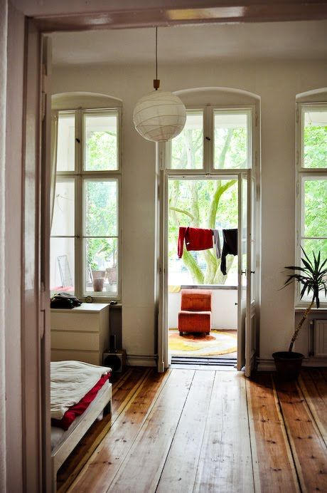 A peek into my ideal living space: great big windows, wood floors, balcony, etc.