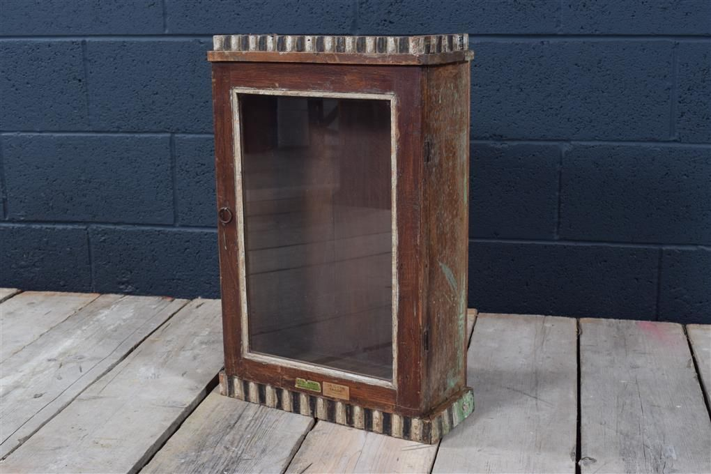 Something is. vintage glass front wall cabinet