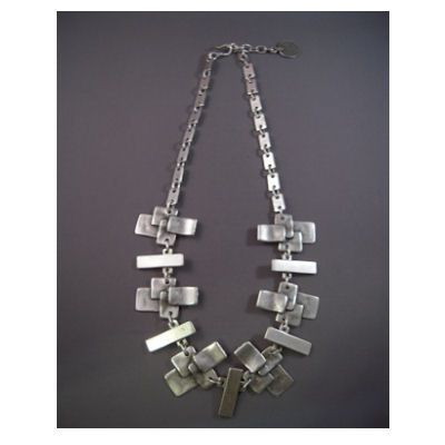 Asymmetrical Silver metal necklace.