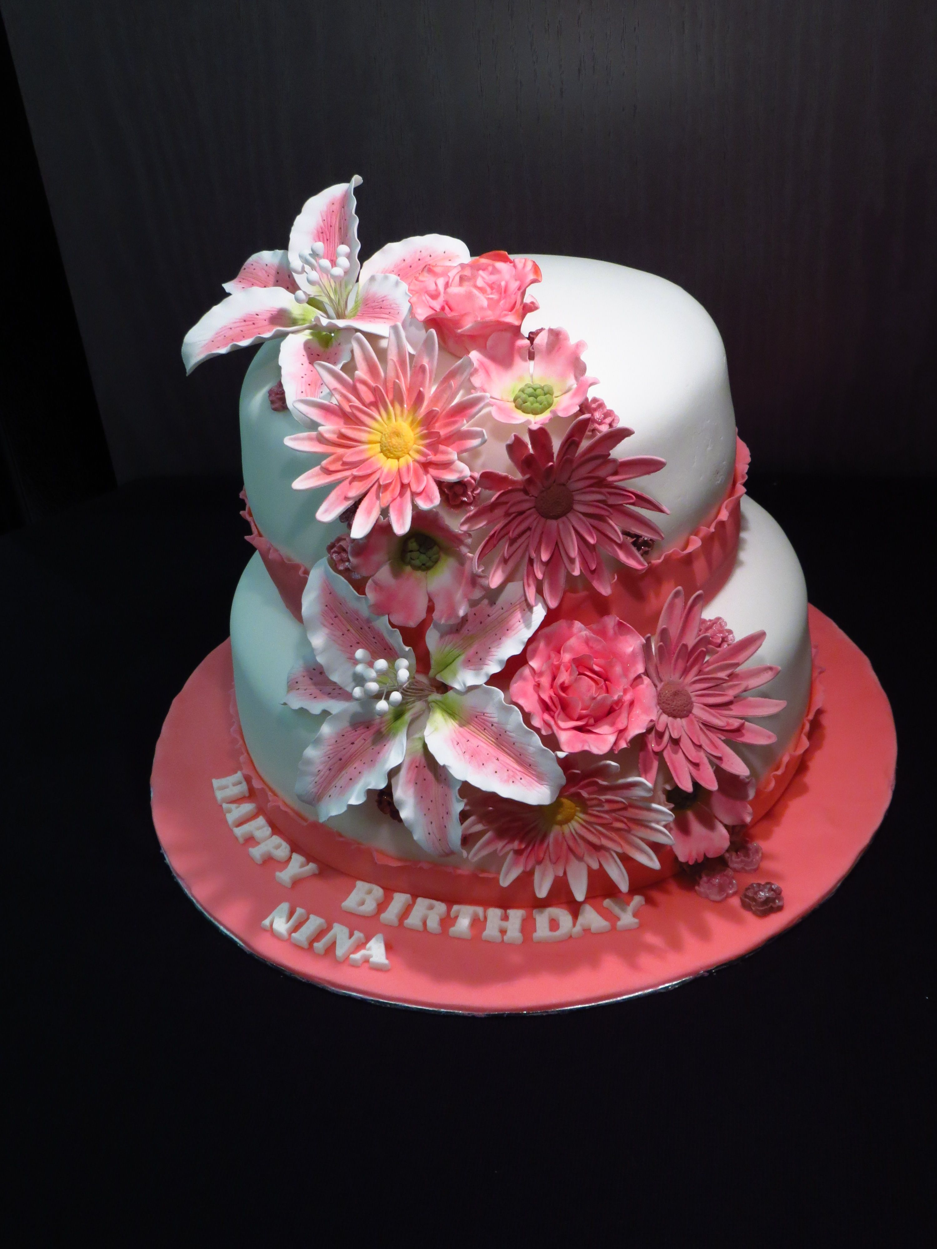 A Tiered Cake With Flowing Pink Fondant Flowers Cake Decorating
