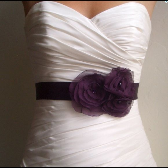 "Purple Flower Bridal Sash, Bridal Accessory This handmade sash is a 1.5"" wide super soft satin sash, measuring 3 yards (9 feet) long.  A cluster of 3 matching dark purple flowers made of hand-singed chiffon, each with a purple crystal in the center.  Flowers measure approximately 4"", 3.5"", and 2.5-3"" in diameter. Message me about customizations.   Original Design and Copyright 2011. All photo rights belong to Bridal Shoppe USA Bridalshoppe Accessories"
