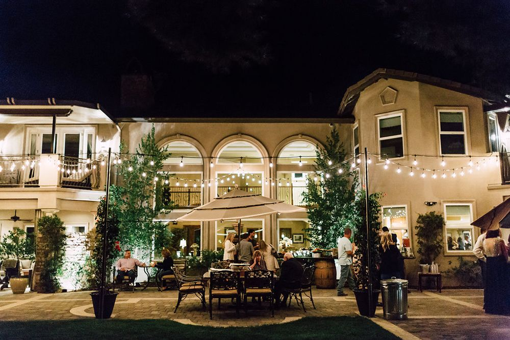 outdoor wedding reception at nightttime - photo by Plum and Oak http://ruffledblog.com/a-california-garden-wedding-with-romantic-florals