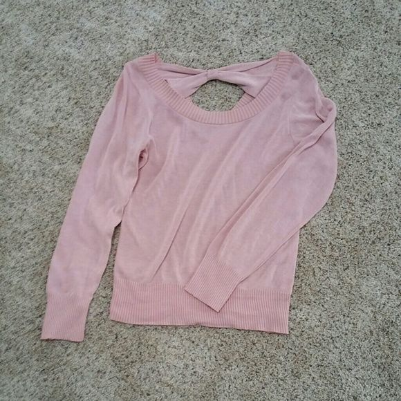dELIA*s pink sweater with bow detail Delia's pink long sleeve sweater with bow detail along back. Does have a little hole under the one arm that I pictured above but is in great condition other than that; never worn. No trades. Sweaters Crew & Scoop Necks