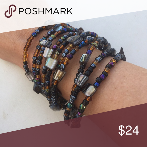 Winter resort 2016 layered boho cuff Handmade in bali, strung from strands of memory wire with gorgeous seed beads and hammered abalone layers. Features open back cuff for a universal fit. Gorgeous statement bracelet for winter resort 2016! handmade Jewelry Bracelets