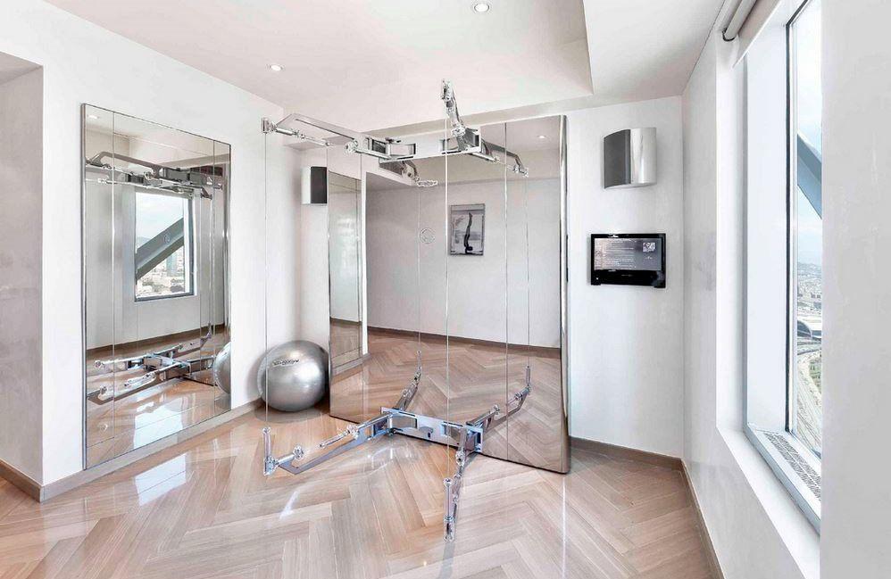 Modern home gym design featuring technogym home gym design