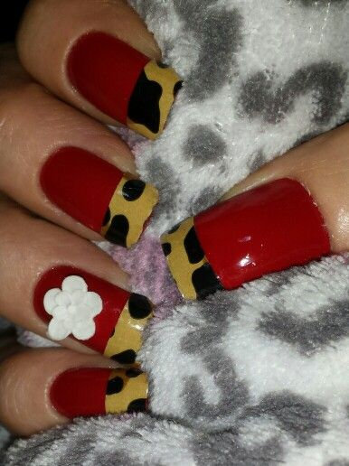 same leopard tip nails with a flower