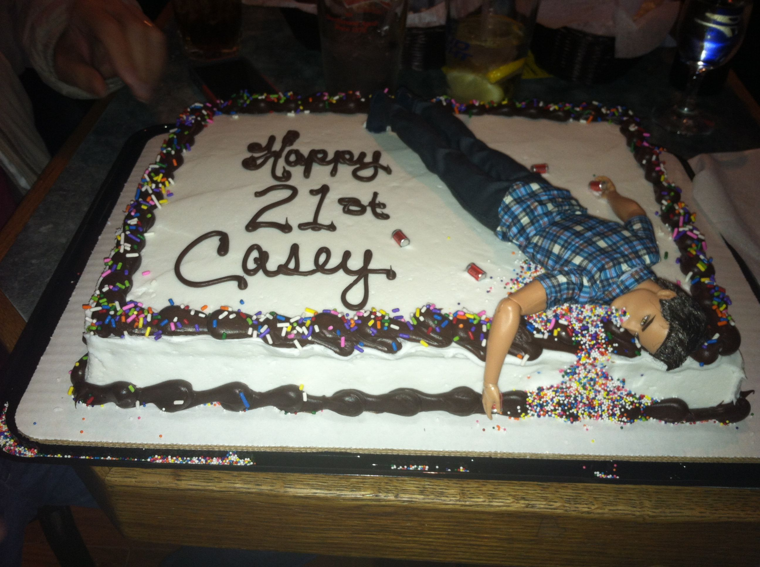 The birthday cake I made for my brothers 21st...A ken doll just casually throwing up some sprinkles after sipping some beers. No big.