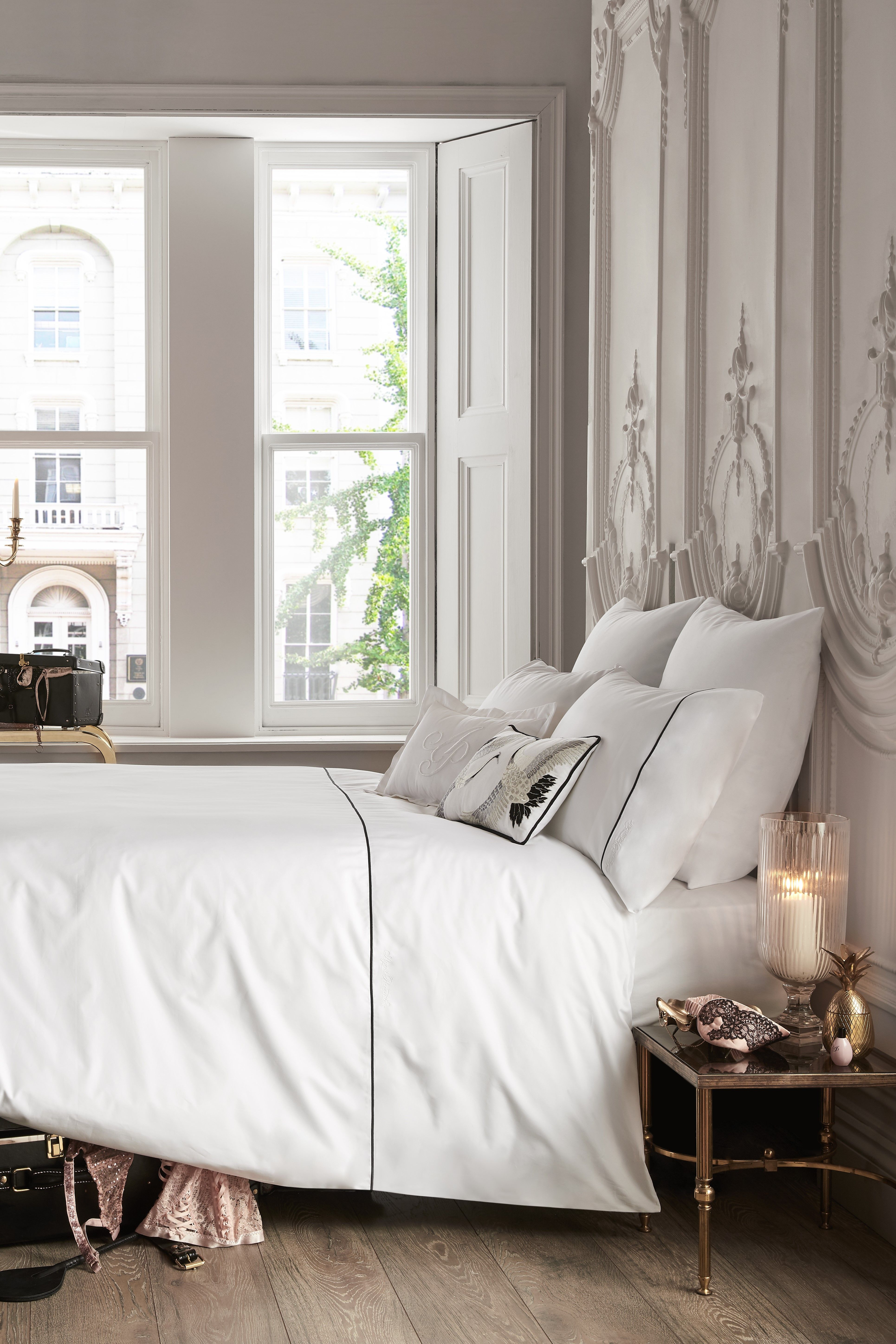 Light and airy, an allwhite bedroom is a timeless classic