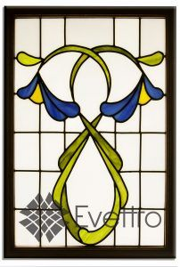 Floral art nouveau stained glass panel with irises