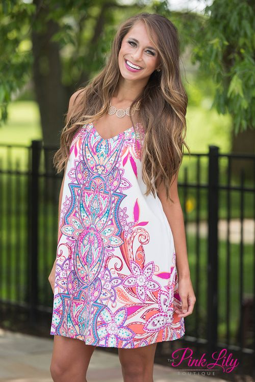 We love this vibrant multicolor dress - it's perfect for dancing the night away under a summer sunset! Featuring shades of orange, hot pink, teal, blue, green, yellow, and cream, this intricate pattern really pops out in a crowd! It also has a v-neckline, spaghetti straps, and soft fabric that will stay comfortable all day long.