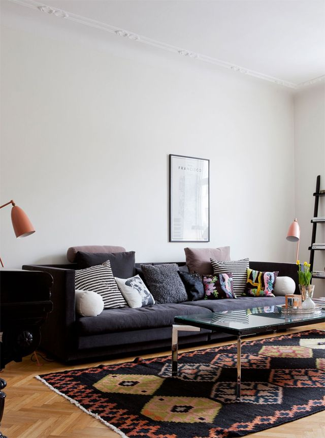 Dark Couch Light Walls Wood Floors And Really Like The Rug