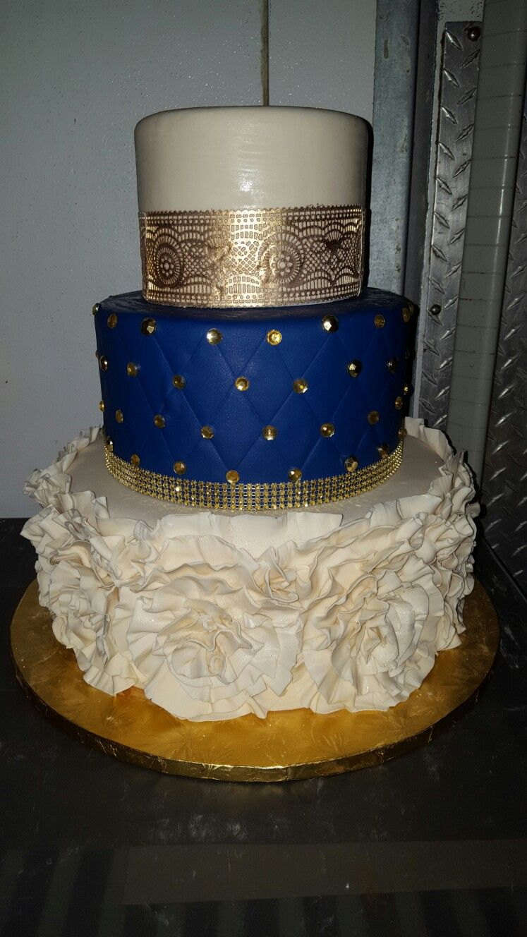 Gold lace and royal blue tiered cake wedding cakes in
