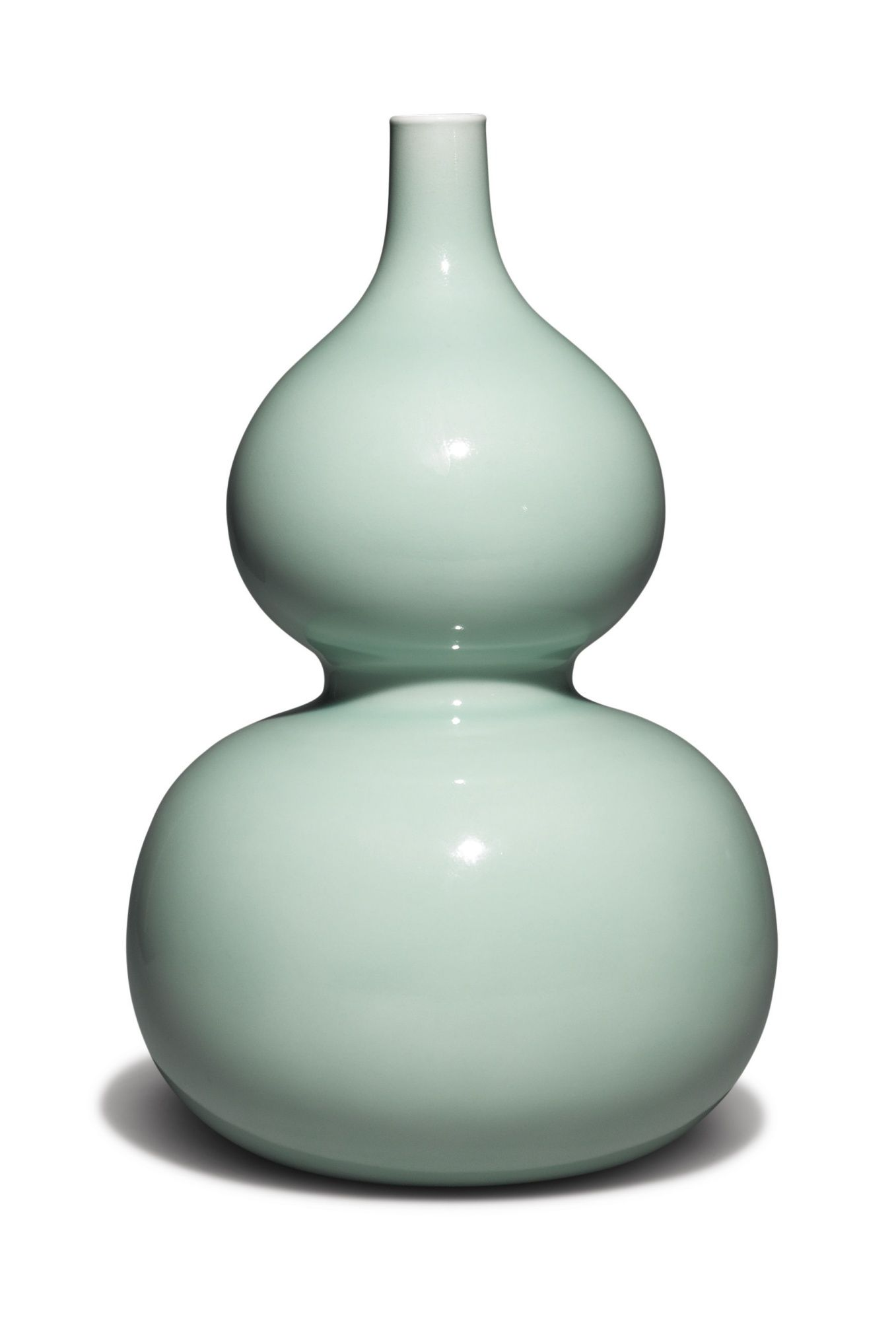 FINE AND RARE CELADON-GLAZED DOUBLE-GOURD VASE, YONGZHENG SEAL MARK AND PERIOD, elegantly potted with two globular bodies and a narrow mouth, covered overall in a lustrous glaze, the recessed base inscribed in underglaze blue with a six-character archaistic seal mark, H 12 5/8 in.