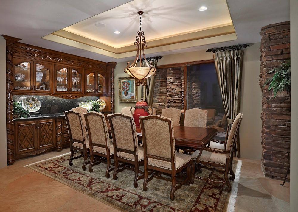Tuscan Influenced Dining Room Coffered Ceiling With Chandelier Recessed And Indirect Ambient Lighting Custom Built Hand Chiseled Cabinet From Mexico