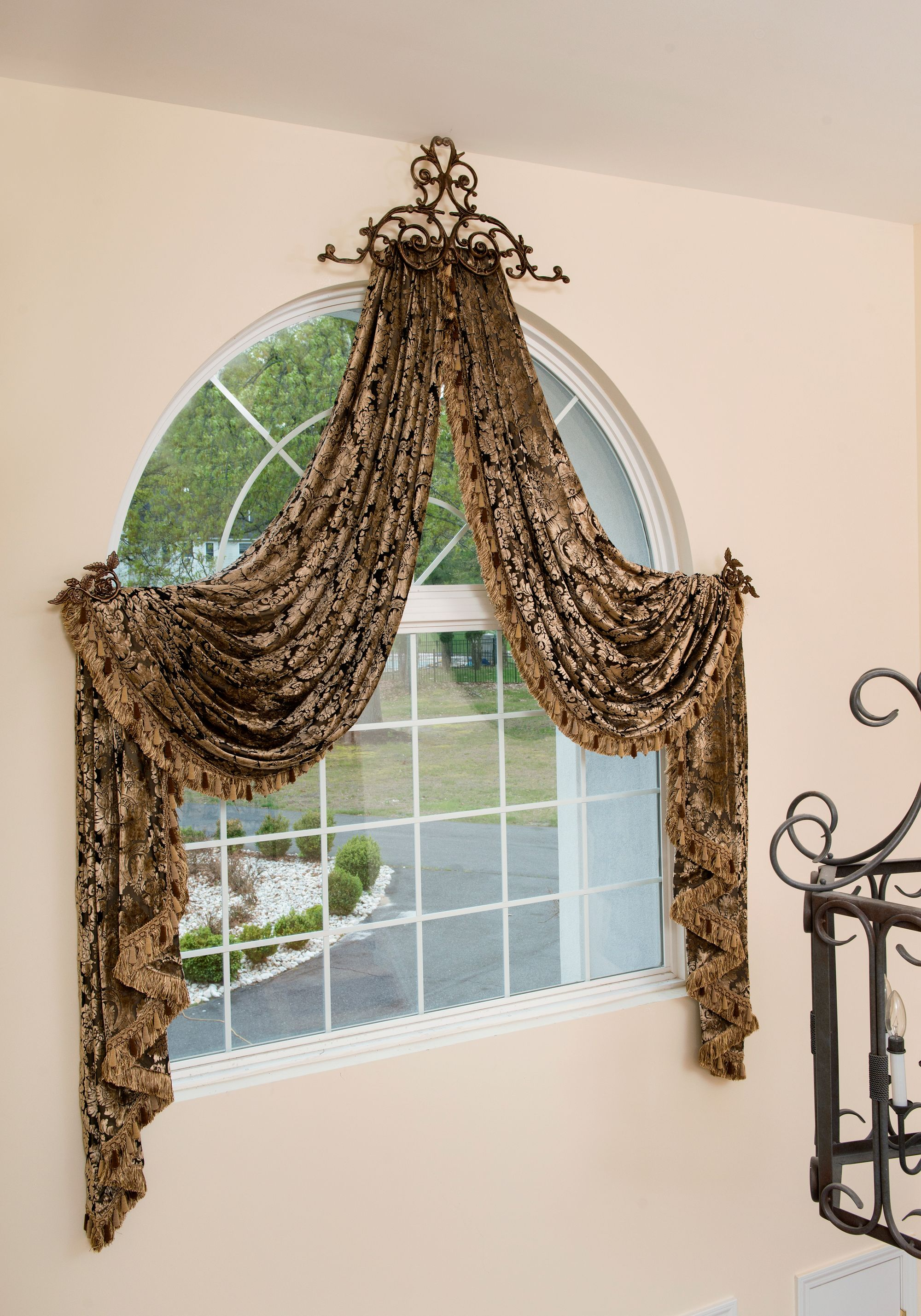 Window dressing ideas for arched windows  arched window treatment with trim allover and metal crown  costura