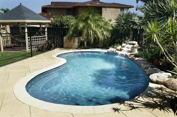 spectacular kidney shaped swimming pools design waterfall feature