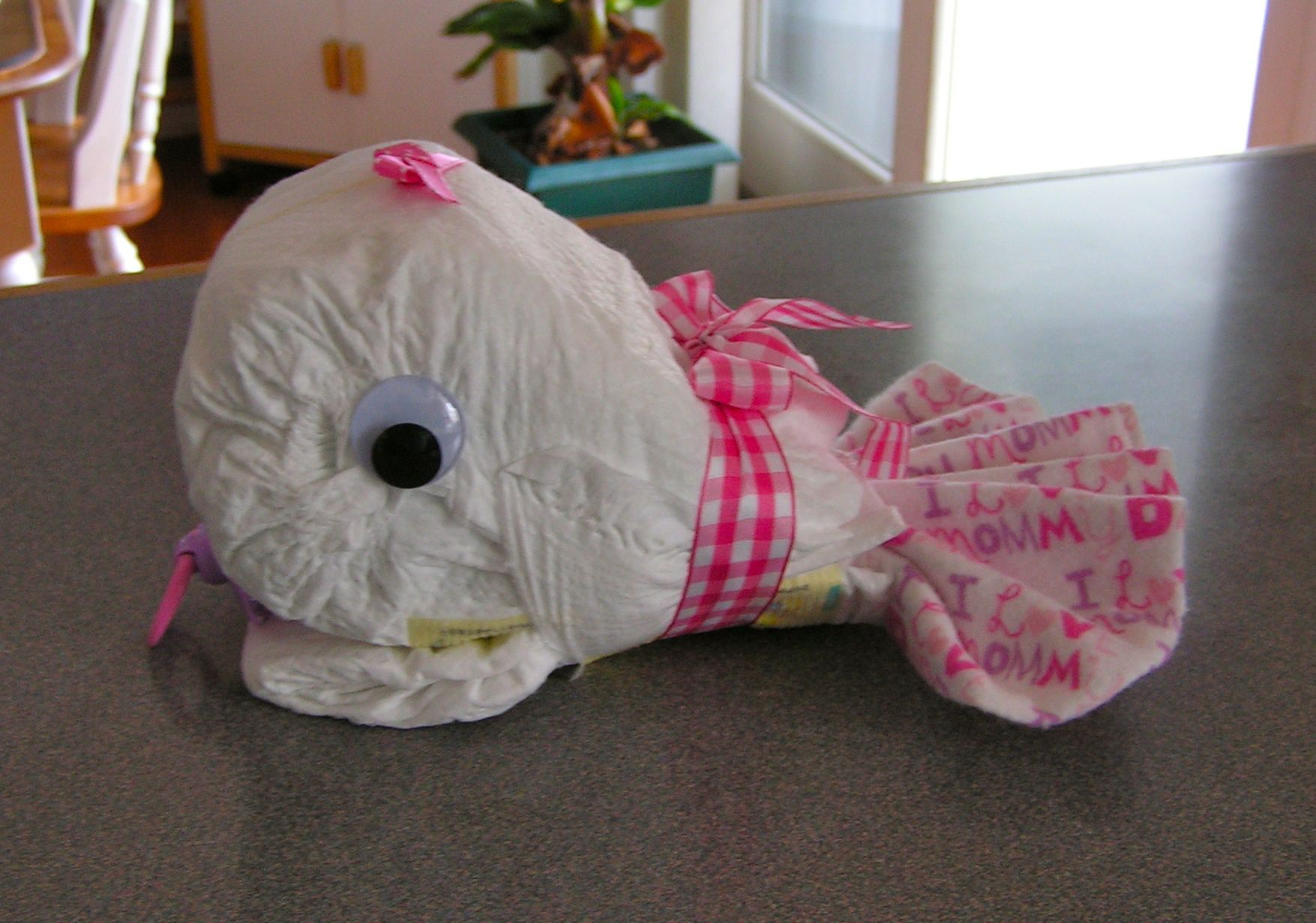 Diaper whale has 8 size 2 pampers.  See my Etsy site for cost.