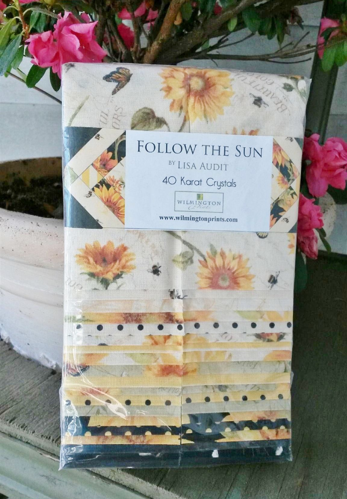 "From the fabric collection 'Follow the Sun' by Lisa Audit for Wilmington Prints... each 40 Karat Crystals pack includes 40 - 2-1/2"" strips of fabric..."