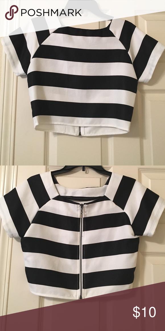 Black/ white striped structured crop top Black/ white striped structured crop top with zipper closure in back. Worn once. Black Tops Crop Tops