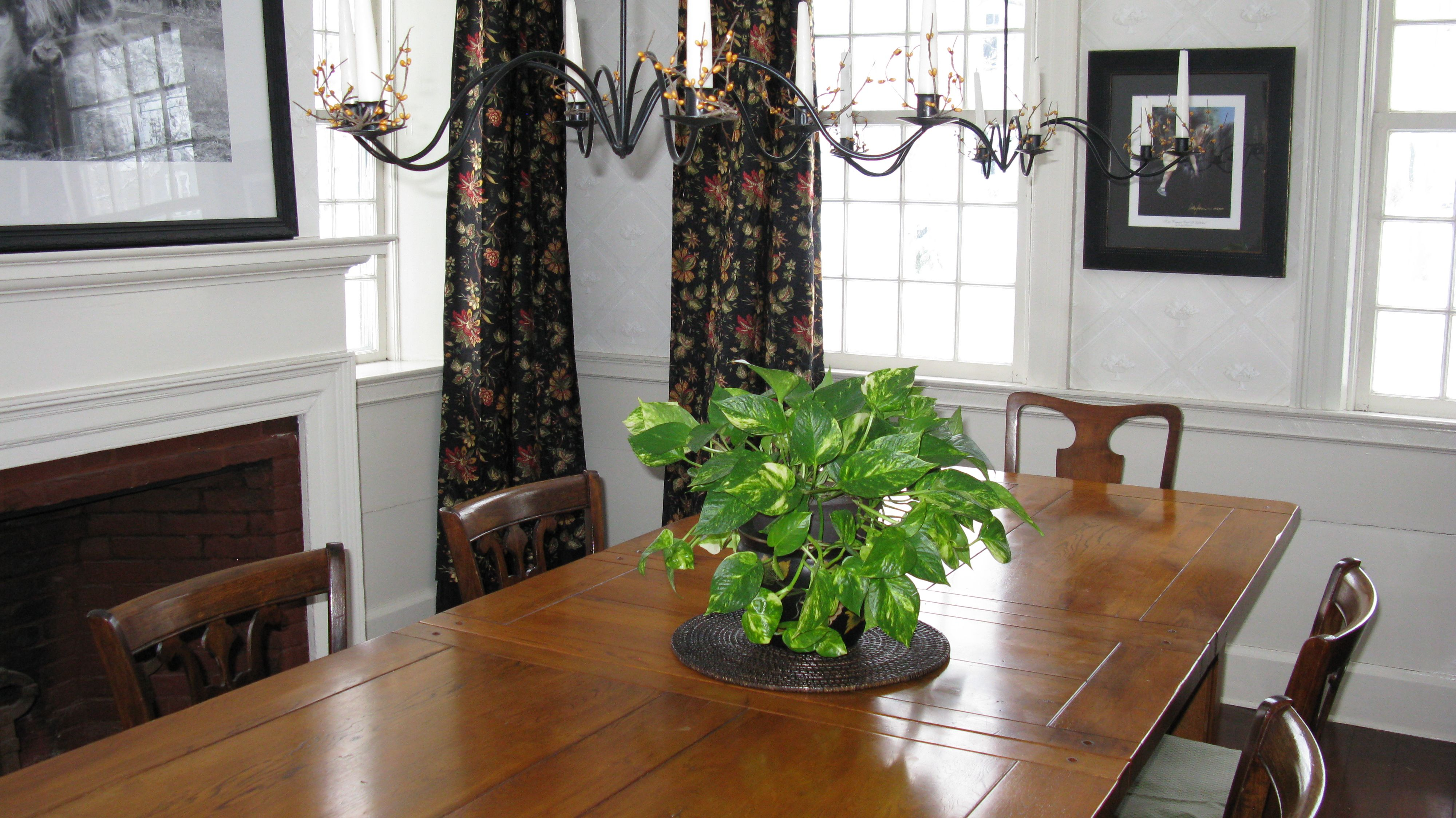 Dining Room Farmhouse Table Flower Drapes Wallpaper Fireplace Candle Chandelier
