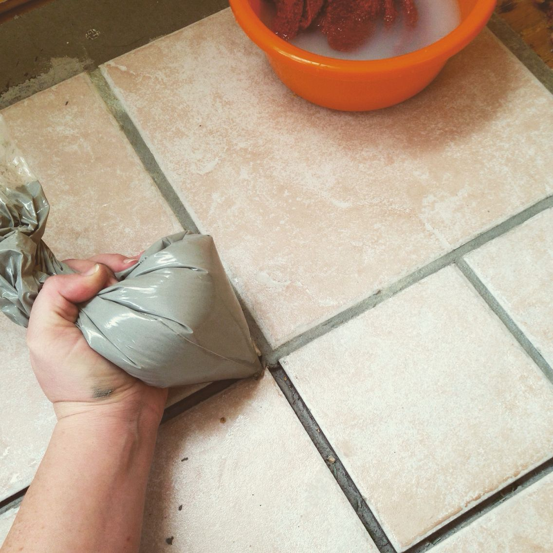 Put those cake decorating skills to work when grouting