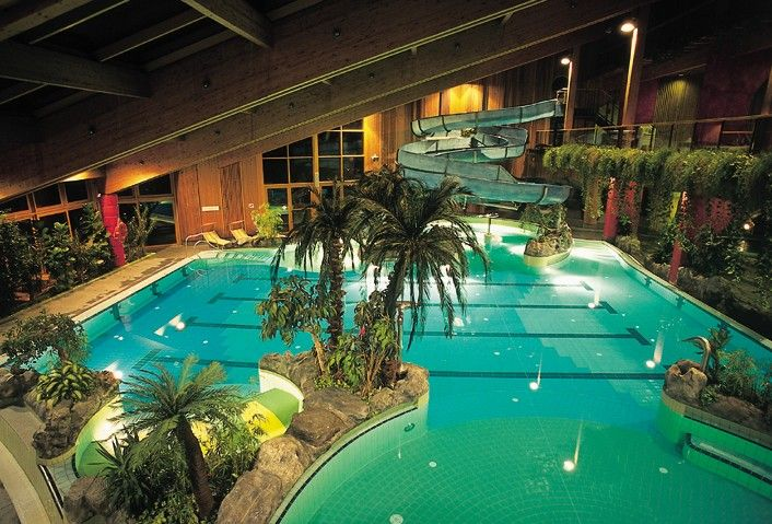 amazing indoor tropical pool with a water slide