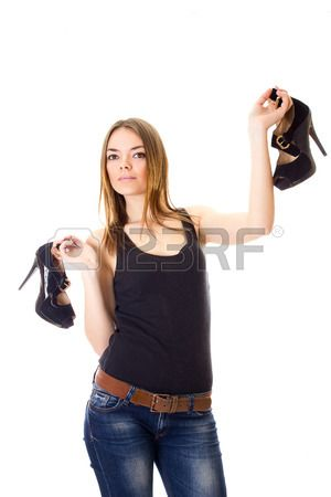 Isolated portrait of a beautiful young woman with smooth brown shoulder-length hair in a black vest and jeans