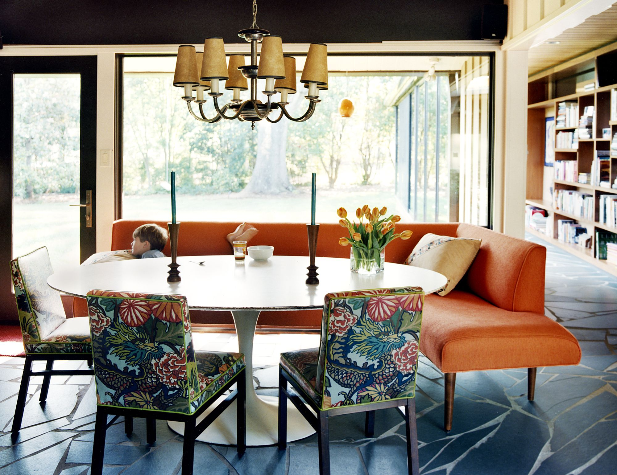 Dining room table with upholstered bench  Chairs upholstered in Schumacherus Chiang Mai Dragon pattern