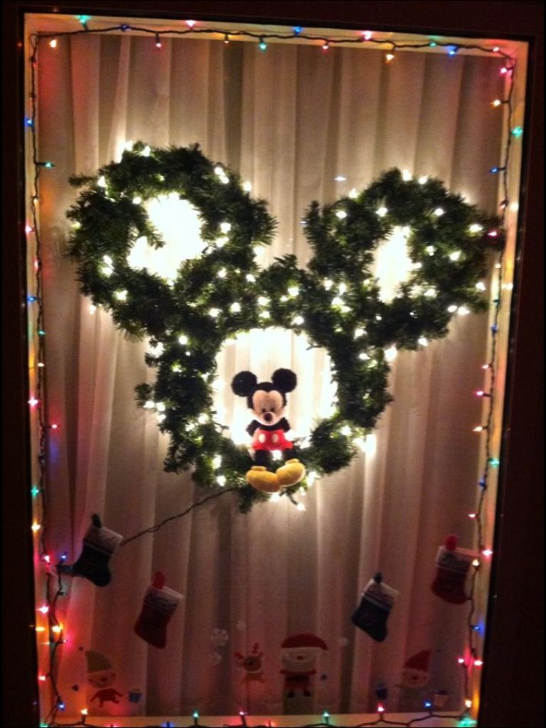 our hotel room window decorated for christmas at disney world