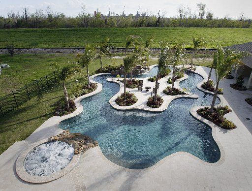 The couple used garden hoses lay out the wavy 4 foot deep for Deep swimming pools for garden