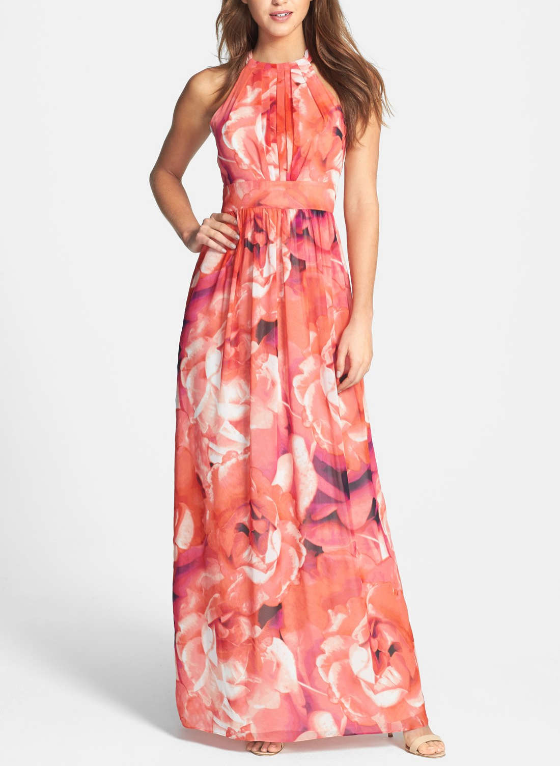 This flattering floral chiffon dress cinches at the waist to