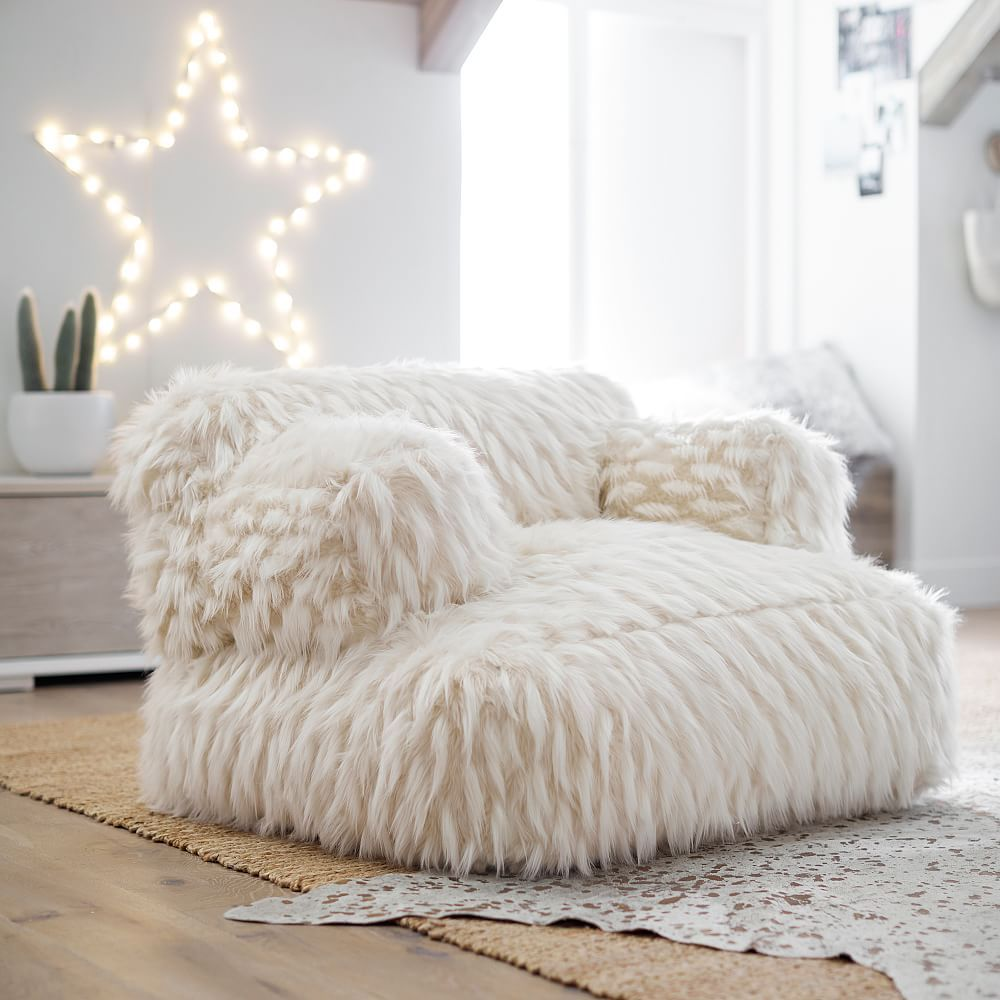 Winter Fox FauxFur EcoLounger is part of Plush chair - Part chair, part beanbag, comfort meets style in this ultraplush lounger that features our luxe fauxfur in a soft neutral palette  Made from ecofriendly recycled materials, you can feel good about relaxing in this heartily crafted seat  DETAI…