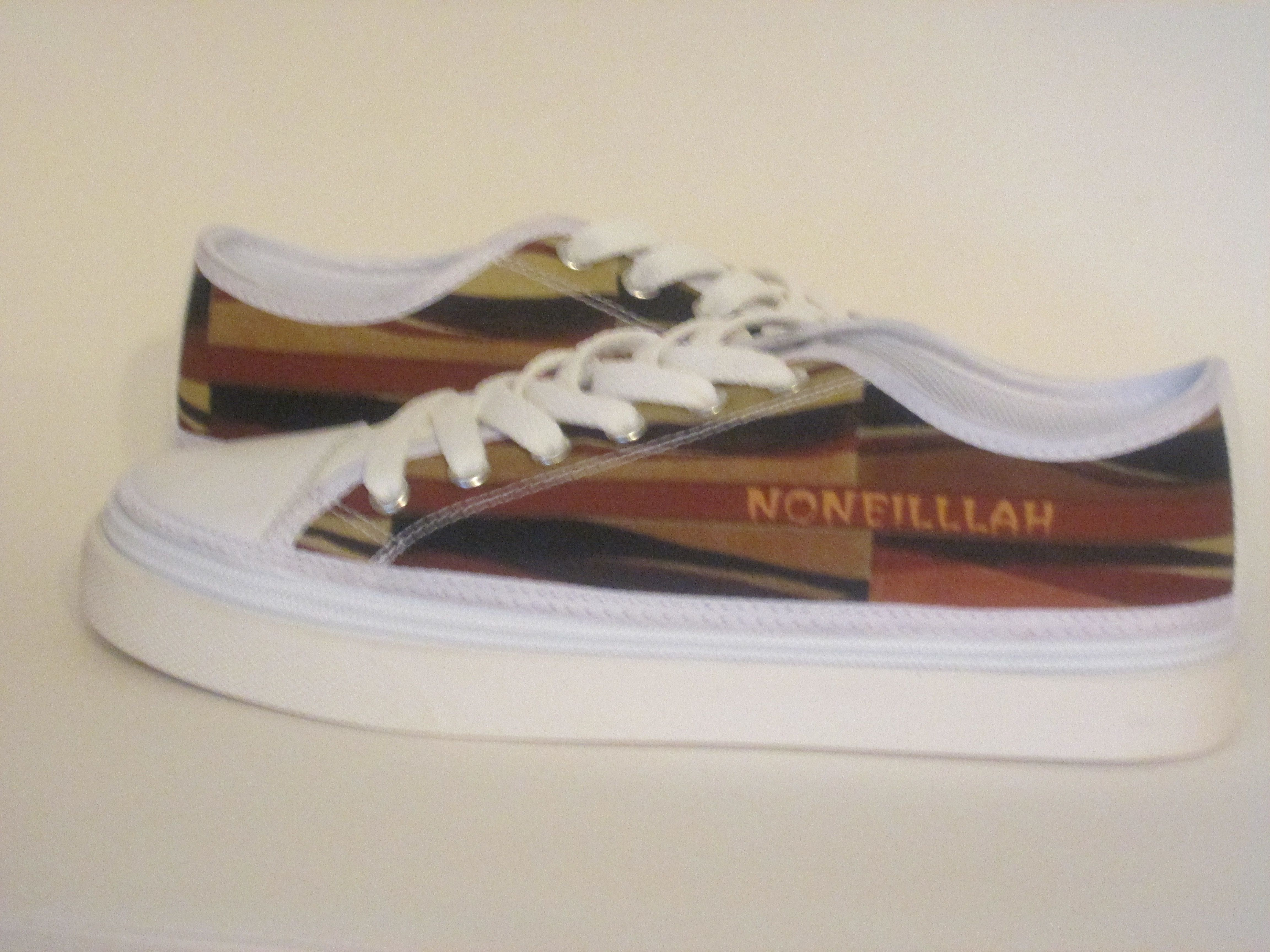 Noneillah's fashionable brown earth tone colors zip off sneakers foot ware is by…