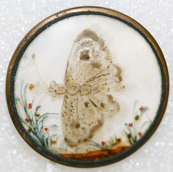 ca 1775 French back painted glass picturing a moth, set in metal.