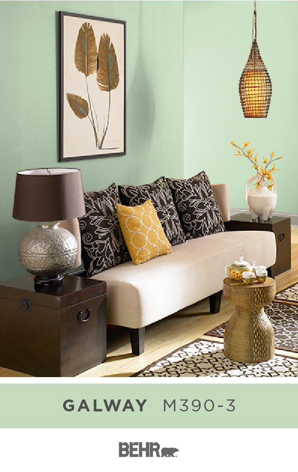 Bold Patterns Warm Wood Tones And Bright Pops Of Yellow Come Together With Behr Paint In Galway T Living Room Warm Warm Living Room Colors Living Room Colors