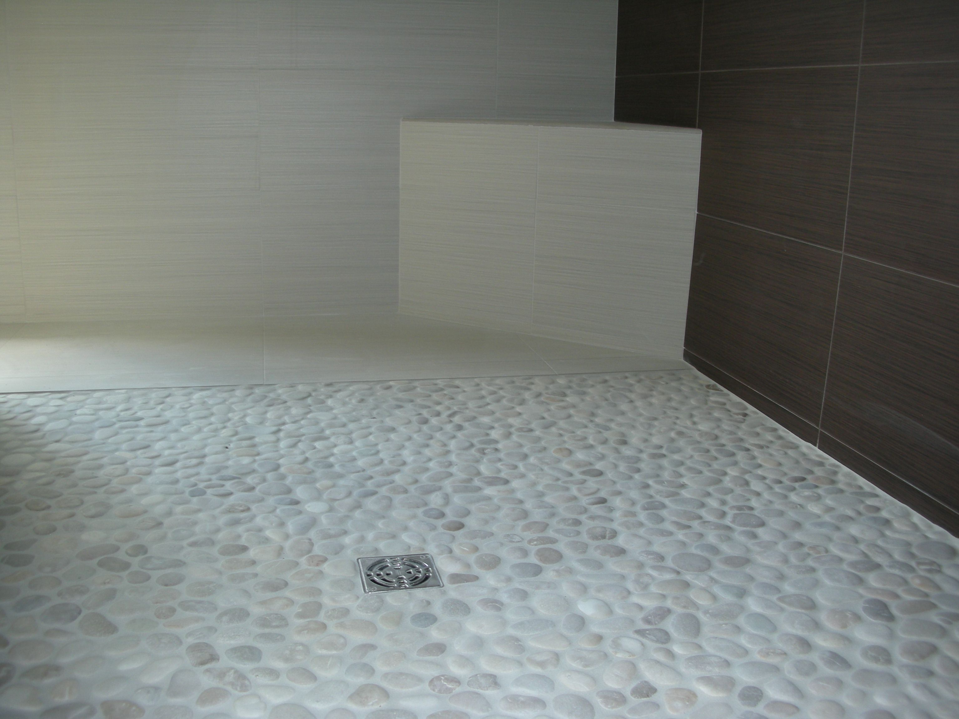 White Pebble Tile | White pebbles, Pebble shower floor and Pebble tiles