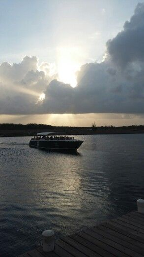 The couple and their guests returning from their own private island. Www.romantictravelbelize. com